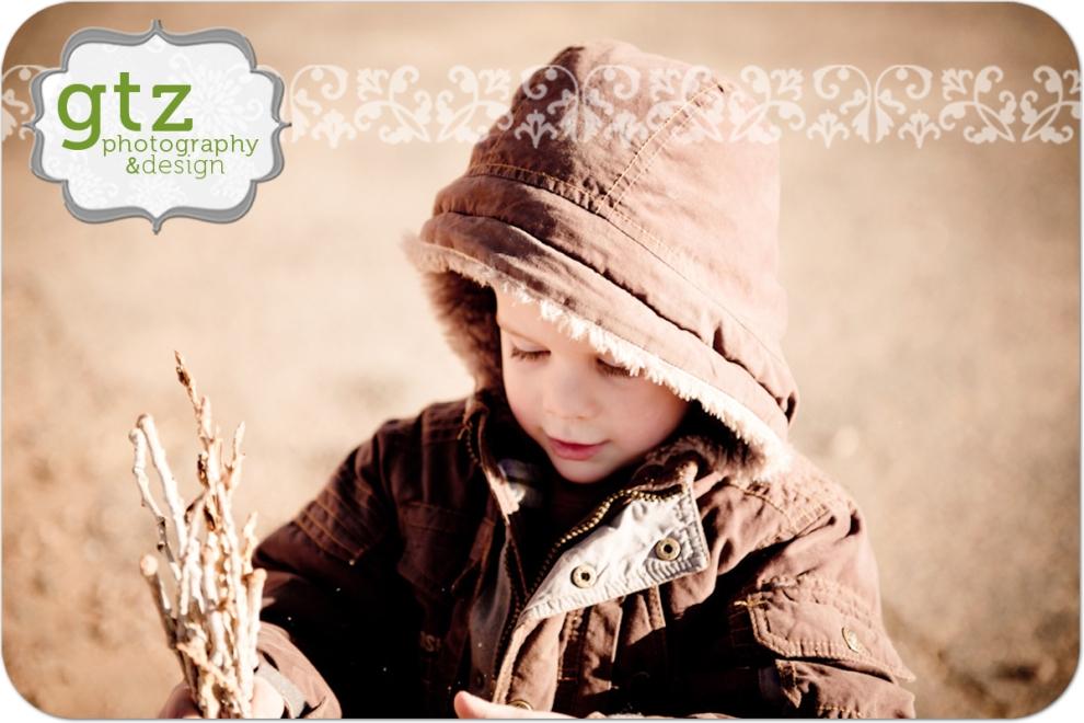 boy in desert with sticks