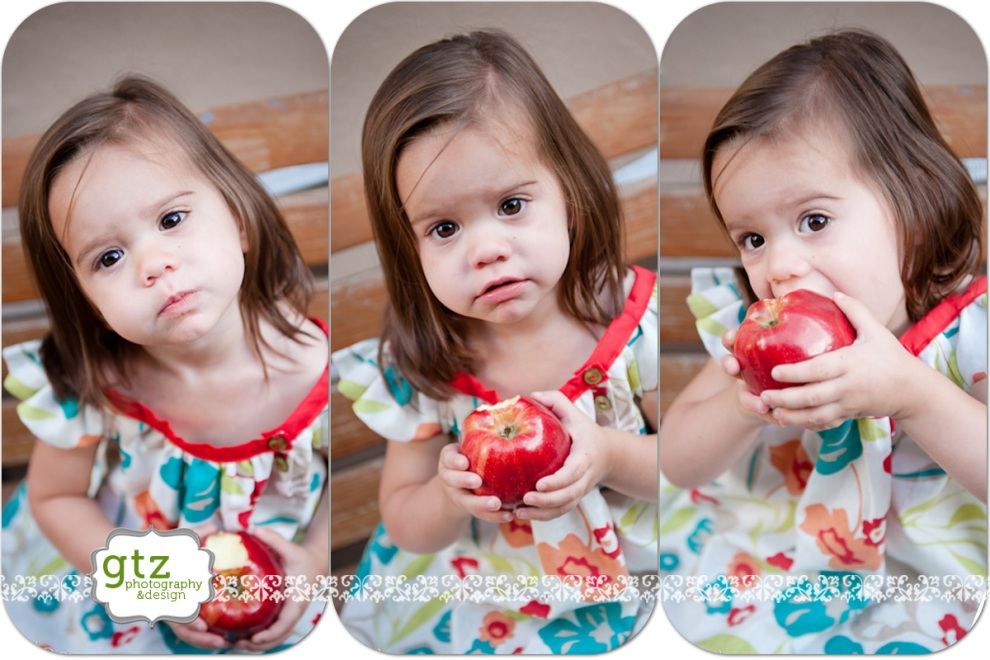 two year old girl eating an apple