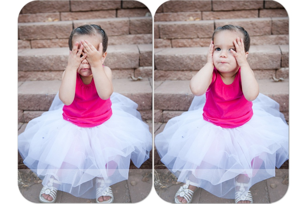 little girl in white tutu playing peekaboo