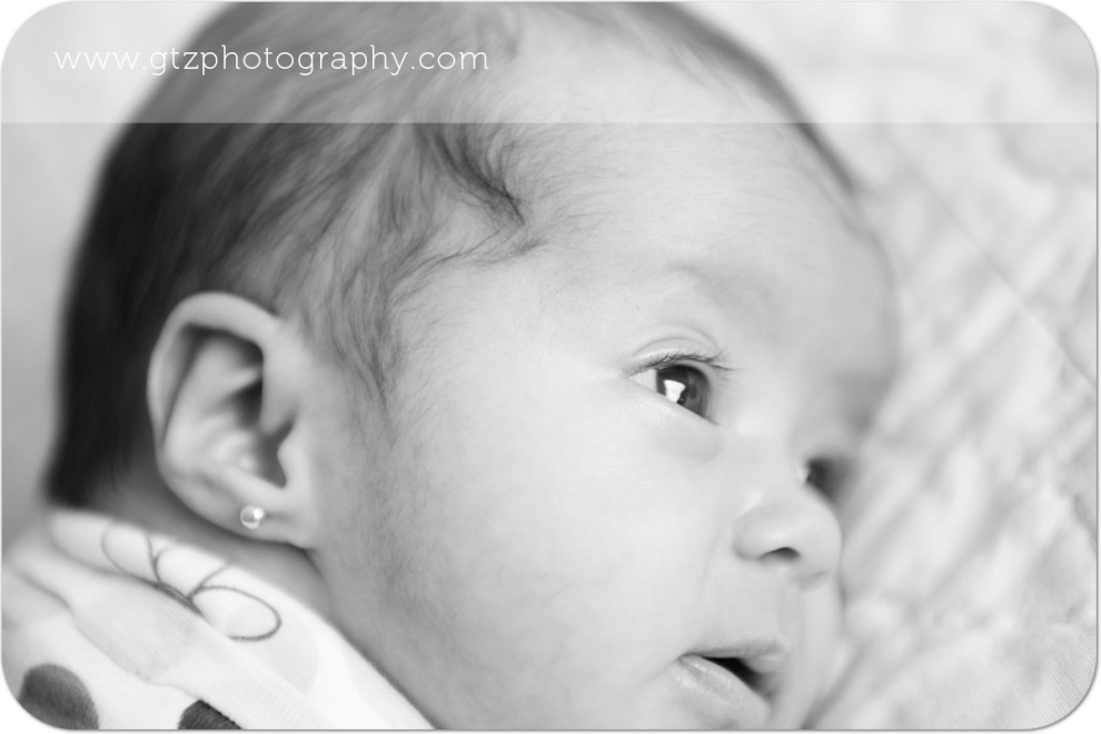 closeup of newborn baby girl with long eyelashes
