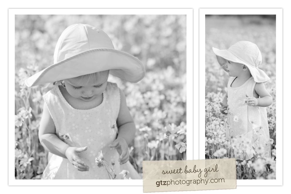 baby girl wearing hat in a field of flowers