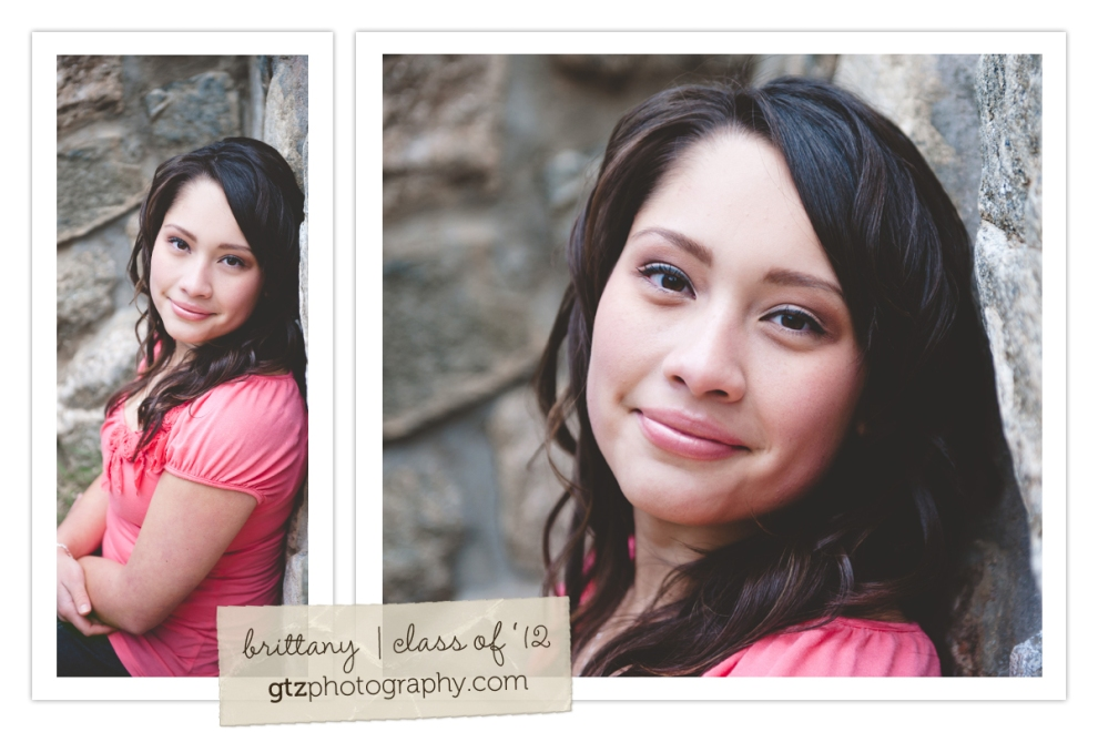 high school senior girl portraits sitting against rock wall