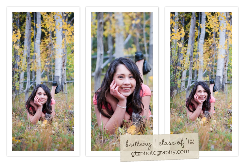 high school senior girl portraits lying in stand of aspens chin in hand