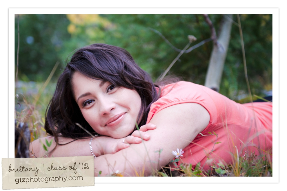 high school senior girl portraits lying on ground chin on arms