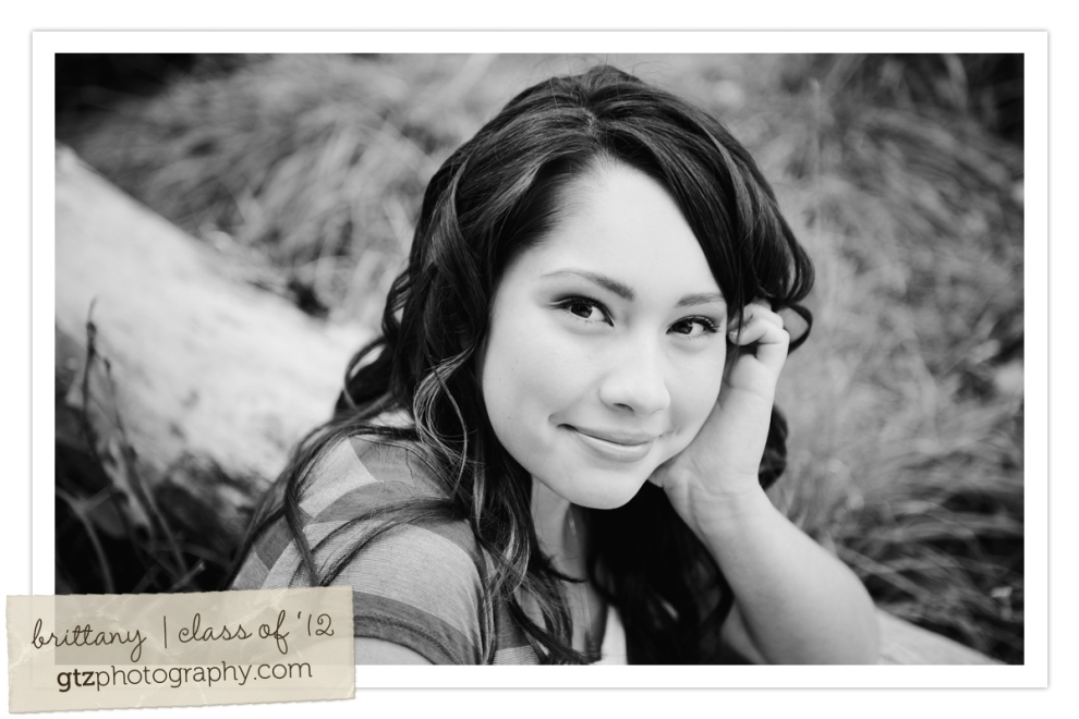 high school senior girl black and white leaning face on hand