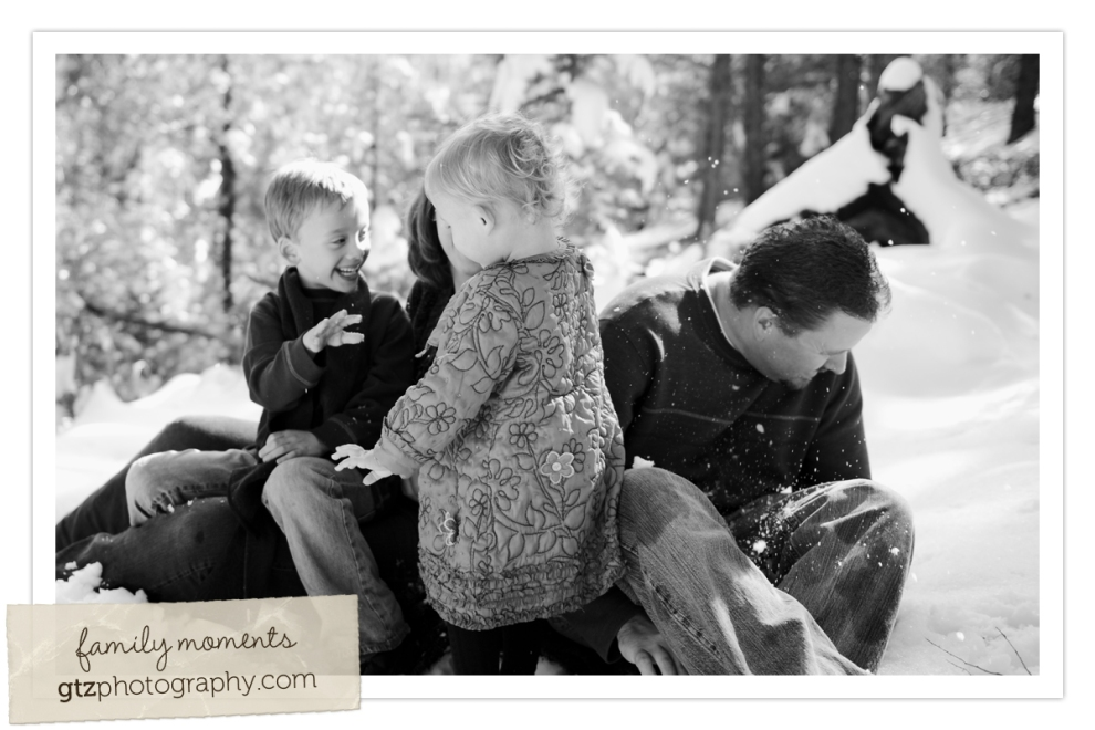black and white family image, son throwing snowball at dad