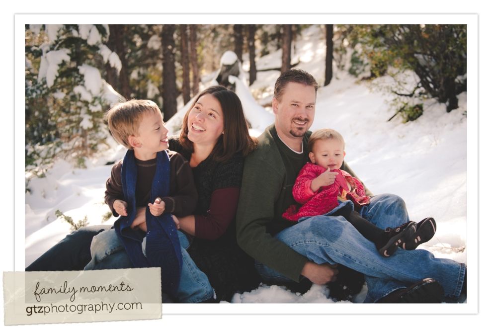 family sitting in snow for family portrait, laughing and smiling, Hyde Park, Santa Fe