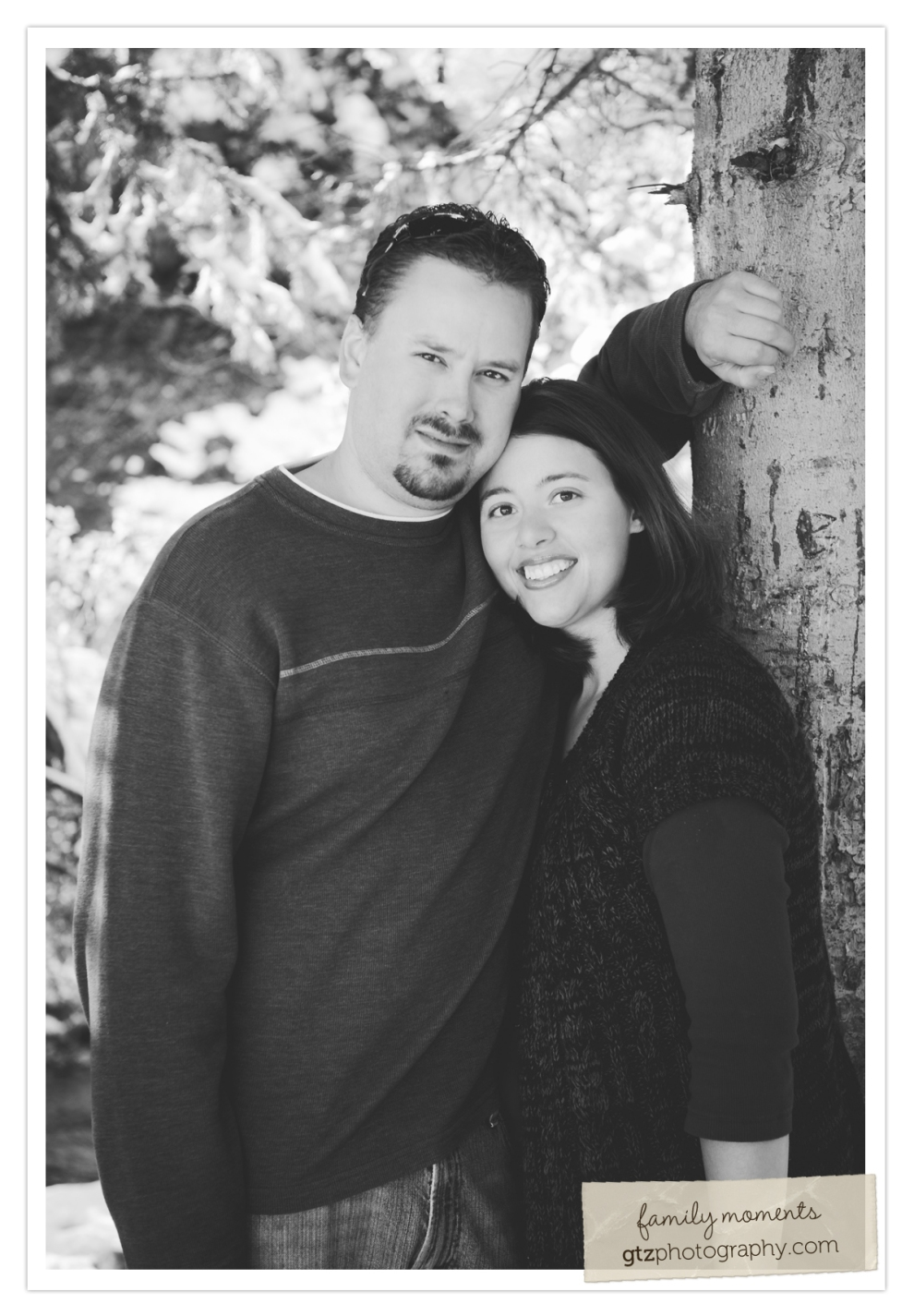 husband and wife black and white portrait by a tree