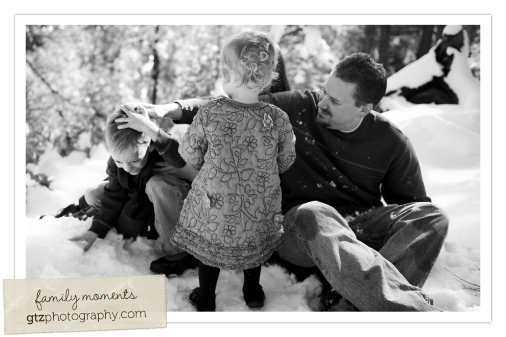 black and white family image, dad rubbing snow on son's head