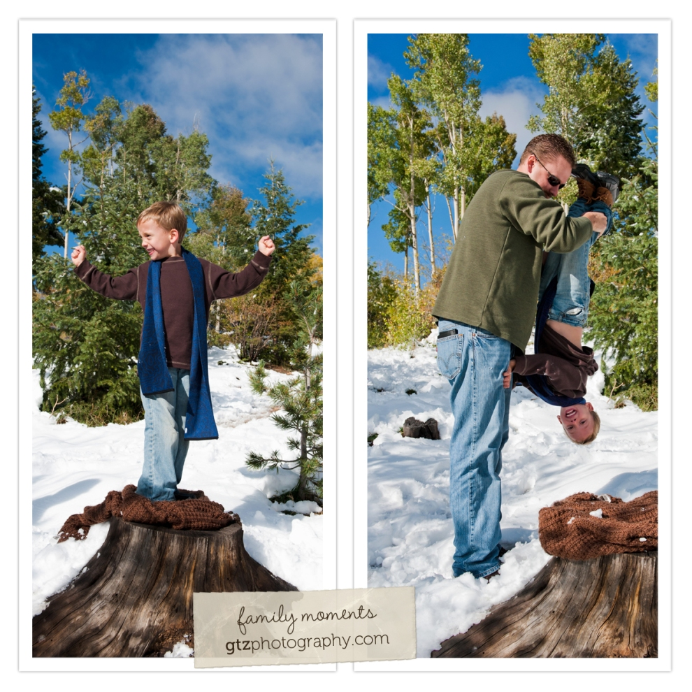 six year old boy standing on tree stump showing muscles; dad turning him upside down