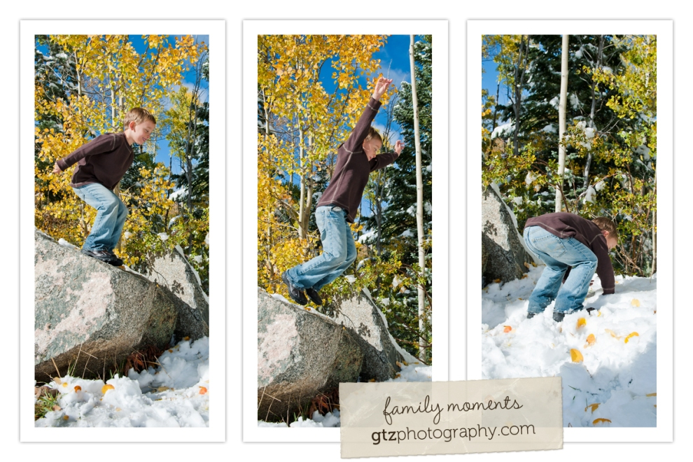 six year old boy jumping off a large rock into the snow