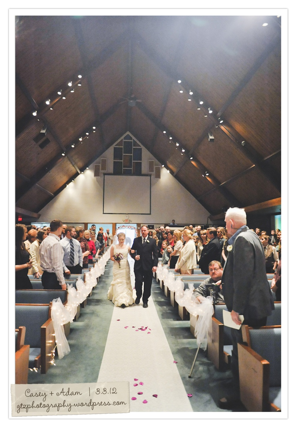 bride and father coming down aisle