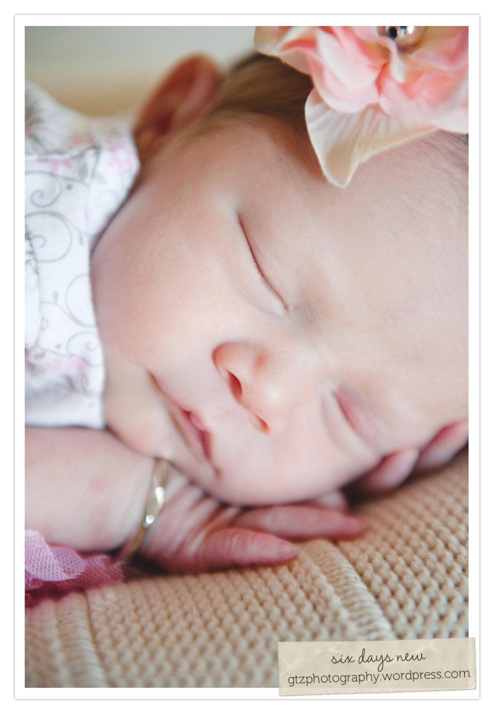 six day old newborn baby girl sleeping